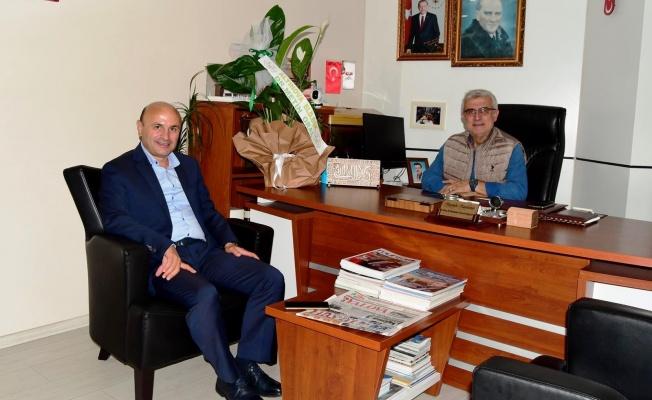 Metin Oral, Muhtarlar Derneği Başkanı'nı kutladı